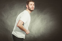 Man suffering from stomach ache abdominal pain. Royalty Free Stock Photography