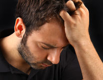 Man suffering a strong headache Stock Images