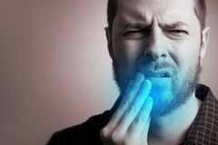 Man suffering from teeth pain. And gum problems - toothache concept royalty free stock images