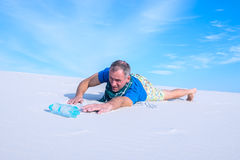 Man suffering from thirst lost in the desert Royalty Free Stock Photography