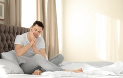 Man suffering from tooth pain. In bedroom royalty free stock photography