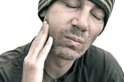 Man suffering from toothache, teeth pain, swollen face Royalty Free Stock Photos