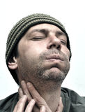 Man suffering from toothache, teeth pain, swollen face Royalty Free Stock Photography