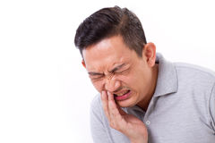 Man suffering from toothache, tooth sensitivity. White isolated background Stock Images