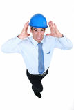 Man suffering from unbearable noise. Man with helmet and unbearable noise Royalty Free Stock Photography