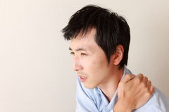 Man suffers from neck ache Royalty Free Stock Photography
