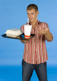 Man suggests fast food meal. Blue background Royalty Free Stock Photos