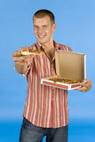 Man suggests pizza. On the blue backgorund Royalty Free Stock Photo