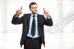 Man with suit. Handsome man wearing suit. His fingers shows up Stock Images