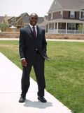 Man in suit. Man in suburban setting Stock Photography