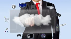 Man In Suit Accessing Media Content Through Cloud Computing royalty free stock photography