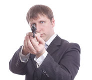 The man in a suit aims from a pistol Royalty Free Stock Photo