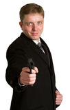 The man in a suit aims from a pistol Royalty Free Stock Photography