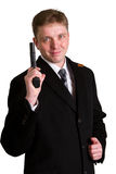 Man in a suit aims from a pistol Royalty Free Stock Image