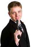 The man in a suit aims from a pistol. Royalty Free Stock Photography