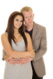 Man suit arms around woman look smile Stock Photography
