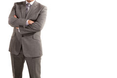 Man In Suit. A man in a suit with arms crossed isolated over white Royalty Free Stock Image