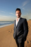 Man in suit at the beach Royalty Free Stock Photography