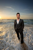 Man in a suit at the beach Royalty Free Stock Photography