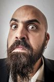 Man with a suit and beard and strange expressions Royalty Free Stock Photography