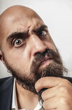 Man with a suit and beard and strange expressions Stock Photo