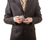 The man in the suit believes dollars isolated on white. Background Stock Photos