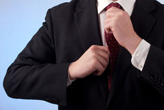Man binding his tie. Man in suit binding his tie Royalty Free Stock Photos