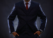 Man in suit on black Stock Image