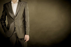 Man in suit. On a black background Stock Photography
