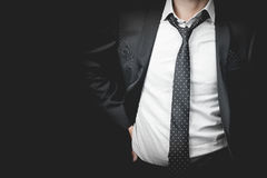 Man in suit on a black background Stock Images