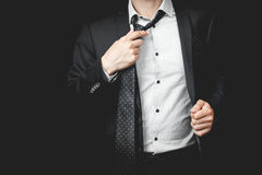 Man in suit on a black background Royalty Free Stock Photos