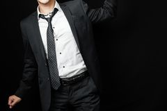 Man in suit on a black background Royalty Free Stock Images