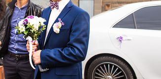 Man in a suit with boutonniere Stock Photos