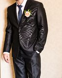 Man in a suit with boutonniere Stock Image