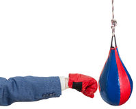 Man in suit with boxing glove punches punching bag Royalty Free Stock Photo