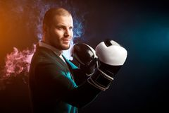 Man in suit boxing stock photo