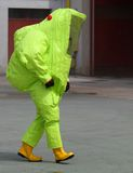 Man with the suit and breathing apparatus to enter contaminated. Fireman with the yellow suit and breathing apparatus to enter contaminated sites in complete royalty free stock photography