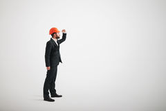 Man in a suit and a building helmet looking to the side Royalty Free Stock Photos