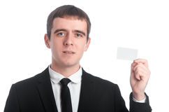 Man in the suit with business card Stock Images