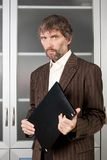 Man in suit with business papers. In folder Stock Image