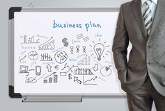 Man in suit and business plan Stock Photo