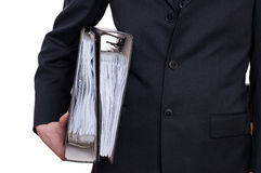 Man in suit is carrying two files Royalty Free Stock Images