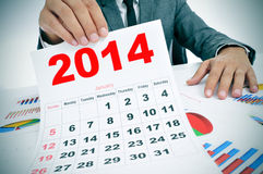 Man in suit with charts and a 2014 calendar Stock Photography