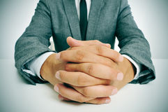 Man in suit with clasped hands Royalty Free Stock Image