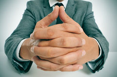 Man in suit with clasped hands Royalty Free Stock Images