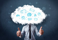 Man in suit with cloud head and blue icons Royalty Free Stock Photos