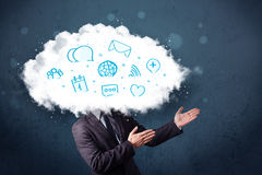 Man in suit with cloud head and blue icons Royalty Free Stock Images