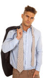 Man suit coat over shoulder look serious tie undone Stock Photos