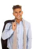 Man suit coat over shouldr tie undone smile Royalty Free Stock Photography