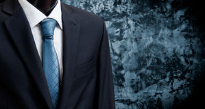 Man in suit on a concrete wall background Royalty Free Stock Photography